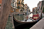 A gondola parked on a canal in Venice, Italy
