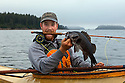 WA09172-00...WASHINGTON - Luke Johansen with black rock fish caught with a fly rod in the Strait of Juan de Fuca. (MR# J9)