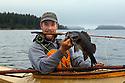 WA09172-00...WASHINGTON - Luke Johansen with black rock fish caught with a fly rod in the Strait of Juan de Fuca. (MR# J9)