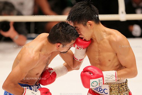 (L to R)  Juan Hernandez (Mex), Kazuto Ioka (JPN), AUGUST 10, 2011 - Boxing : Juan Hernandez of Mexico hits Kazuto Ioka of Japan during the WBC Minimum weight title bout at Korakuen Hall, Tokyo, Japan. Kazuto Ioka of Japan won the fight on points after twelve rounds. (Photo by Yusuke Nakanishi/AFLO) [1090]