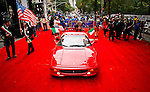 A Ferrari car is seen on a long red carpet as people take part of the Annual Columbus day parade in New York, United States. 08/10/2012. Photo by Eduardo Munoz Alvarez / VIEWpress.