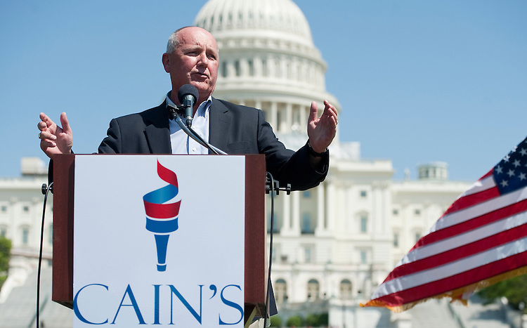 UNITED STATES  APRIL 16: Candidate for Senate and former Rep. Pete Hoekstra, R-Mich.,right, speaks during Herman Cain's Revolution on the Hill Tax Day Rally in Washington on MOnday, April 16, 2012. (Photo By Bill Clark/CQ Roll Call)