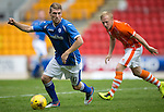 St Johnstone v Blackpool...25.07.15  McDiarmid Park, Perth.. Pre-Season Friendly<br /> David Wotherspoon gets away from Mark Cullen<br /> Picture by Graeme Hart.<br /> Copyright Perthshire Picture Agency<br /> Tel: 01738 623350  Mobile: 07990 594431