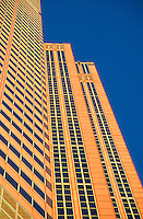 """Detail view of a striking pattern on the facade of a modern skyscaper at sunset.   The architecture of Chicago has influenced and reflected the history of American architecture. The city of Chicago, Illinois features prominent buildings in a variety of styles by many important architects. Since most buildings within the downtown area were destroyed by the Great Chicago Fire in 1871, Chicago buildings are noted for their originality rather than their antiquity..Beginning in the early 1880s, architectural pioneers of the Chicago School explored steel-frame construction and, in the 1890s, the use of large areas of plate glass. These were among the first modern skyscrapers and amongst their most famous architects were William LeBaron, John Wellborn Root Sr., Daniel Burnham and Charles Atwood. Louis Sullivan was perhaps the city's most philosophical architect. Realizing that the skyscraper represented a new form of architecture, he discarded historical precedent and designed buildings that emphasized their vertical nature. This new form of architecture, by Jenney, Burnham, Sullivan, and others, became known as the """"Commercial Style,"""" but it was called the """"Chicago School"""" by later historians..Since 1963, a """"Second Chicago School"""" emerged, largely due to the ideas of structural engineer Fazlur Khan. Some of Chicago's skyscrapers such as the John Hancock Center, Willis Tower (formerly known as the Sears Tower) and The Trump International Hotel and Tower are amongst the tallest buildings in the world. The architecture of Chicago has influenced and reflected the history of American architecture. The city of Chicago, Illinois features prominent buildings in a variety of styles by many important architects. Since most buildings within the downtown area were destroyed by the Great Chicago Fire in 1871, Chicago buildings are noted for their originality rather than their antiquity..Beginning in the early 1880s, architectural pioneers of the Chicago School explored steel-frame con"""