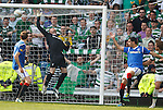 Thomas Rogne loops a header over Allan McGregor as Celtic snatch a second consolation goal