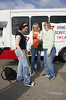 USN Sailors Rachel Blomstrom (L) of Houston Texas and Kate Wilson (C) of Buffalo, New York who are attached to the Fleet Anti-Submarine Warfare Training Center in Point Loma San Diego California meet with Sharon Roberts (R) of San Diego, Thursday November 22, 2007.  Roberts was taking the pair home for Thanksgiving Dinner as part of the Armed Services YMCA Adopt-a-Sailor program that pairs sailors who would otherwise spend the holiday alone with local families.  The San Diego Armed Services YMCA has organized the program for San Diego based sailors every year for the past 65 years.  Blomstrom had injured her foot at a music concert the previous Sunday.