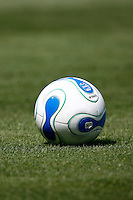 20 May 2007: MLS blue and white soccer ball on green grass. Sports equipment detail.