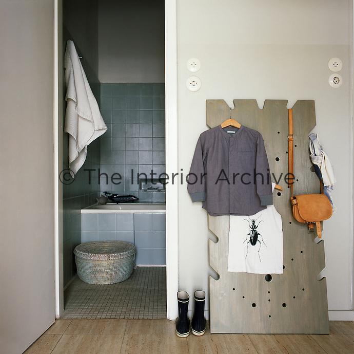 An open doorway leads to a grey tiled en suite bathroom