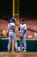 SAN FRANCISCO, CA - Chan Ho Park and Mike Piazza of the Los Angeles Dodgers talk on the mound during a game against the San Francisco Giants at Candlestick Park in San Francisco, California in 1996. (Photo by Brad Mangin)