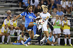 06 September 2013: UCLA's Darian Jenkins (11) and North Carolina's Katie Bowen (NZL) (15) challenge for the ball. The University of North Carolina Tar Heels played the University of California Los Angeles Bruins at Koskinen Stadium in Durham, NC in a 2013 NCAA Division I Women's Soccer match. UNC won the game 1-0.