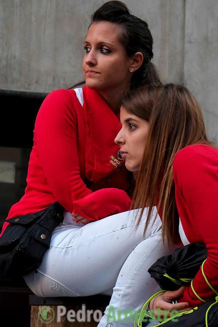 Two women attend the first bull run of the San Fermin Festival, on July 7, 2013, in Pamplona, northern Spain. The festival is a symbol of Spanish culture that attracts thousands of tourists to watch the bull runs despite heavy condemnation from animal rights groups. AFP PHOTO/ PEDRO ARMESTRE