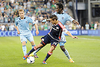 Diego Fagundez (14) New England shields the ball from Kei Kamara (23) Sporting KC... Sporting Kansas City defeated New England Revolution 3-0 at LIVESTRONG Sporting Park, Kansas City, Kansas.