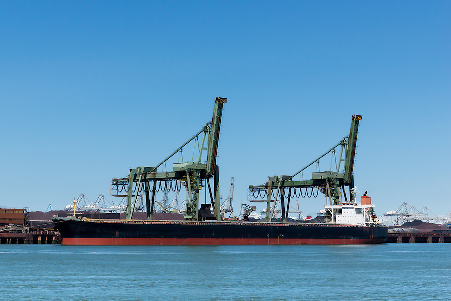 Large vessel unloading its iron ore cargo