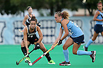 18 September 2015: North Carolina's Eva van't Hoog (NED) (22) and Louisville's Katie Walsh (15). The University of North Carolina Tar Heels hosted the University of Louisville Cardinals at Francis E. Henry Stadium in Chapel Hill, North Carolina in a 2015 NCAA Division I Field Hockey match. UNC won the game 5-0.