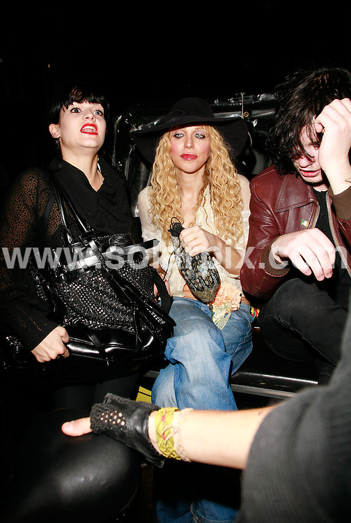 **ALL ROUND PICTURES FROM SOLARPIX.COM**.*WORLDWIDE RIGHTS*.Courtney Love made a brief pitstop at Groucho Club in a rickshaw with some friends. Whilst Courtney and a girlfriend went into the club, a male friend waited for them in the rickshaw. She came out to pose in the.rickshaw for photographers and then rode off into the city laughing with her friends. Courtney had sparkling contact lenses in her eyes. 13th September 2007..This pic: Courtney Love..JOB REF: 4707 GMT   DATE: 13_09_2007.**MUST CREDIT SOLARPIX.COM OR DOUBLE FEE WILL BE CHARGED* *UNDER NO CIRCUMSTANCES IS THIS IMAGE TO BE REPRODUCED FOR ANY ONLINE EDITION WITHOUT PRIOR PERMISSION*