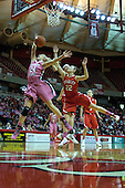 12 February 2012:  Catie O'Leary disrupts a shot by Katy Winge during an NCAA women's basketball game Where the Bradley Braves lost to the Illinois Sate Redbirds 82-63.  It was Play 4Kay day in honor of the cancer research fund set up by Coach Kay Yow at Redbird Arena in Normal IL