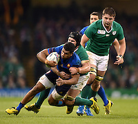 Wesley Fofana of France is tackled to ground by Sean O'Brien of Ireland. Rugby World Cup Pool D match between France and Ireland on October 11, 2015 at the Millennium Stadium in Cardiff, Wales. Photo by: Patrick Khachfe / Onside Images