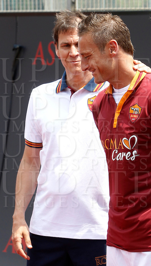 L'allenatore francese della Roma Rudi Garcia ed il capitano Francesco Totti, a destra, alla presentazione delle nuove maglie, al centro sportivo di Trigoria, Roma, 11 luglio 2013.<br /> AS Roma football team's coach Rudi Garcia, of France, and captain Francesco Totti, right, attend the presentation of the new jerseys at the club's sporting centre on the outskirts of Rome, 11 July 2013.<br /> UPDATE IMAGES PRESS/Isabella Bonotto