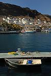 Wheel barrow in rowing boat tied up to pontoon Puerto Mogan, Gran Canaria, Canary Islands, Spain