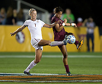 Dagny Brynjarsdottir (7) of Florida State fights for the ball with Candace Cephers (18) of Virginia Tech during the Women's College Cup semifinals at WakeMed Soccer Park in Cary, NC. Florida State defeated Virginia Tech, 3-2.