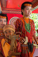 family member in traditional costume  at a traditional funeral in a village in Toraja land, Sulawesi, Indonesia