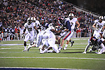 Ole Miss quarterback Bo Wallace (14) vs. Vanderbilt safety Kenny Ladler (1) at Vaught-Hemingway Stadium in Oxford, Miss. on Saturday, November 10, 2012.