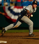 06/19/2006 Rice University's Greg Buchanan tries to toss the ball to second base after making a fielding error in the third inning during game eight of the College World Series in Omaha Nebraska Monday evening..(photo by Chris Machian/Prairie Pixel Group)