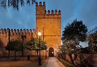 Torre de los Leones, built 1662 and now the main entrance, and  ramparts of the Alcazar de los Reyes Cristianos or Palace of the Catholic Kings, rebuilt during the Umayyad Caliphate in the 10th century and used as a royal fortress by the Moors and the Christians, as a base for the Spanish Inquisition, and as a prison, in Cordoba, Andalusia, Southern Spain. The alcazar is a national monument of Spain, and the historic centre of Cordoba is listed as a UNESCO World Heritage Site. Picture by Manuel Cohen