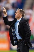 Sporting Kansas City manager Peter Vermes. (Note the lining of the jacket) Sporting Kansas City defeated the New York Red Bulls 1-0 during a Major League Soccer (MLS) match at Red Bull Arena in Harrison, NJ, on April 17, 2013.