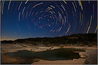 Star Trails circle the North Star for over an hour in this exposure. Taken at Pedernales Falls State Park in the Texas Hill Country.