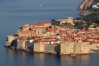The medieval walled city with its defensive walls, 11th century Lovrijenac Fortress and the 14th century Fortress of St John or Mulo Tower protecting the harbour, Dubrovnik, Croatia. The city developed as an important port in the 15th and 16th centuries and has had a multicultural history, allied to the Romans, Ostrogoths, Byzantines, Ancona, Hungary and the Ottomans. In 1979 the city was listed as a UNESCO World Heritage Site. Picture by Manuel Cohen