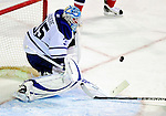 10 April 2010: Toronto Maple Leafs' goaltender Jean-Sebastien Giguere makes a first period save against the Montreal Canadiens at the Bell Centre in Montreal, Quebec, Canada. The Maple Leafs defeated the Canadiens 4-3 in sudden death overtime. Mandatory Credit: Ed Wolfstein Photo