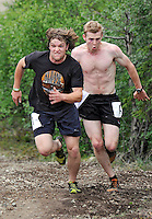 Ian Stewart/Yukon News<br /> Nansen Murray, left, and Cody Renne sprint to the finish line during the Midnight Dome Race in Dawson City on Saturday.