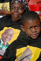 People wear Jacob Zuma t-shirts at an African National Congress (ANC) election rally held at the Ellis Park Stadium in Johannesburg..