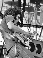 Jerry Garcia in action playing Guitar with The Grateful Dead at Dillon Stadium in Hartford CT on 31 July 1974. Close in sidelong shot. Photograph by Mike Thut | www.terrapinstudio.com | Mike will personally produce and sign your print.