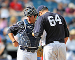 5 March 2011: New York Yankees' catcher Austin Romine chats with Romulo Sanchez during a Spring Training game against the Washington Nationals at George M. Steinbrenner Field in Tampa, Florida. The Nationals defeated the Yankees 10-8 in Grapefruit League action. Mandatory Credit: Ed Wolfstein Photo