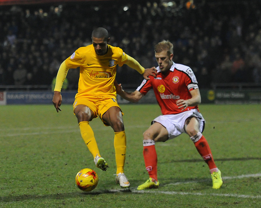 Preston North End's Jermaine Beckford holds off the challenge from Crewe Alexandra's Harry Davis<br /> <br /> Photographer Craig Thomas/CameraSport<br /> <br /> Football - The Football League Sky Bet League One - Crewe Alexandra v Preston North End - Sunday 28th December 2014 - Alexandra Stadium - Crewe<br /> <br /> &copy; CameraSport - 43 Linden Ave. Countesthorpe. Leicester. England. LE8 5PG - Tel: +44 (0) 116 277 4147 - admin@camerasport.com - www.camerasport.com