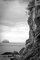 The Royal Clipper, a five masted schooner cruises past the ancient landscape of the Amalfi Coast, Italy