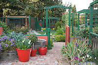 Painted entry arbor, trellis, and gate into brick patio, Rosalind Creasy front yard garden