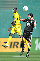 Daniel Woorlard (21) of D.C. United head the ball against Dominic Oduro (11) of the Columbus Crew. The Columbus Crew defeated D.C. United 2-1 ,at RFK Stadium, Saturday March 23,2013.