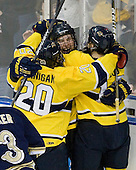 Kyle Bigos (Merrimack - 3) celebrates his goal with Ryan Flanigan (Merrimack - 20), Jesse Todd (Merrimack - 16). - The University of Notre Dame Fighting Irish defeated the Merrimack College Warriors 4-3 in overtime in their NCAA Northeast Regional Semi-Final on Saturday, March 26, 2011, at Verizon Wireless Arena in Manchester, New Hampshire.
