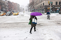 Pedestrians trudge through the snow in the Chelsea neighborhood of New York on Tuesday, March 14, 2017. Originally predicted as a blizzard with up to 20 inches of snow the storm has changed its course and only 4 to 6 inches of snow, sleet and rain are expected, accompanied by howling winds of course. (© Richard B. Levine)
