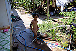 Hien, 4, bathes in clean water provided by the Tien Phat enterprise in the Luong Hoa Lac commune.