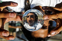 A man playing with a ball of plastic during a demonstration in support of the legalization of marijuana in Bogota, May 4, 2013. Photo by Freddy Builes / VIEWpress.