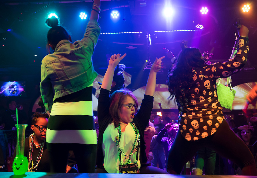 NEW ORLEANS - CIRCA FEBRUARY 2014: People dancing and celebrating Mardi Mardi Gras at a nightclub in the French Quarter in New Orleans