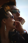 Fashion-conscious young couple in sunglasses, closeup. No model release.