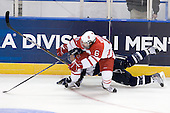 John Henrion (UNH - 16), Chris Wideman (Miami - 6) - The University of New Hampshire Wildcats defeated the Miami University RedHawks 3-1 (EN) in their NCAA Northeast Regional Semi-Final on Saturday, March 26, 2011, at Verizon Wireless Arena in Manchester, New Hampshire.