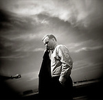 August 23-26, 2003<br /> Howard Dean for America: Presidential Campaign<br /> <br /> Howard Dean, on a cellular phone, before getting on a plane in Spokane, WA<br /> <br /> First published 2004
