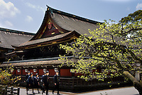 pupils in uniform visiting a temple in Kyoto, Japan