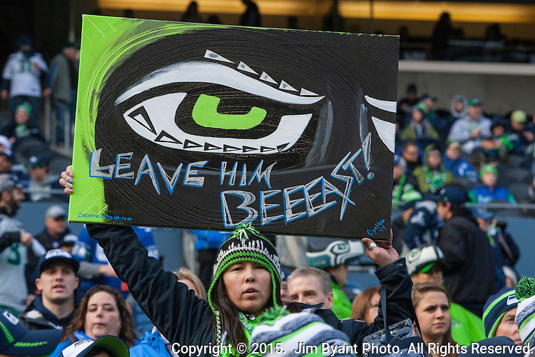 A Seattle Seahawks fan waves a poster and cheers for the Seahawks during the NFC Championship game against  the Green Bay Packers at CenturyLink Field in Seattle, Washington on January 18, 2015.  The Seattle Seahawks beat the Green Bay Packers in overtime 28-22 for the NFC Championship Seattle  ©2015. Photo by Jim Bryant. All Rights Reserved.